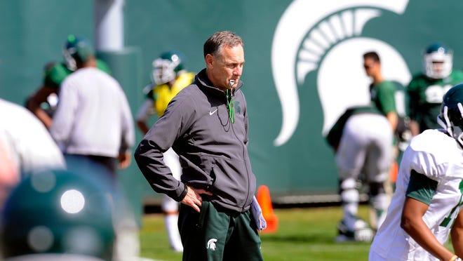 MSU head coach Mark Dantonio watches during practice on campus in East Lansing Tuesday 4/14/2015 .