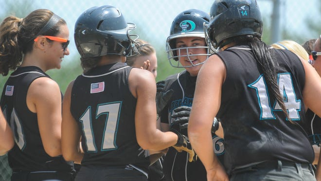 Kelly Cullen is greeted at the plate after hitting a home run for the Delaware Diamonds White on Wednesday.