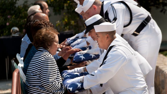 Helen Chavez, widow of Cesar Chavez, accepts a flag from Petty Officer Marco Valovinos. Thursday was the 22nd anniversary of Chavez's death.