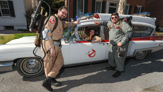 John Hollyday, left of Hartly, Sara Tjaden and Jeffe Rodriguez of New Castle with The Delaware Ghostbusters pose with their Ecto-1 replica car in Dover. They will be at The News Journal's presentation of Ghostbusters at Wilmington Film Festival.