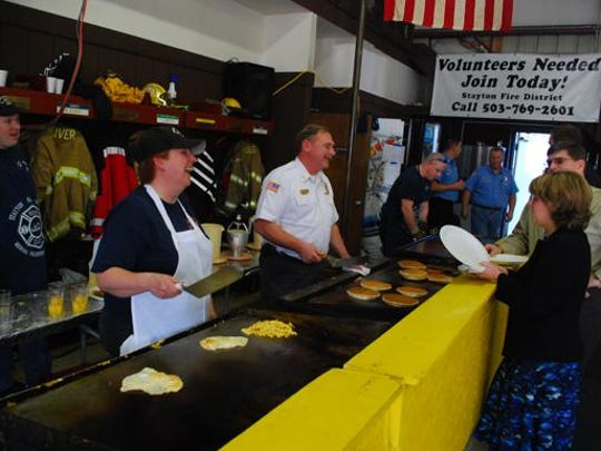 Volunteer firefighters have a good time at the Mehama Fire Station Sweetheart Benefit Breakfast