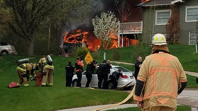 Firefighters battling the structure fire while under the cover of responding law enforcement.