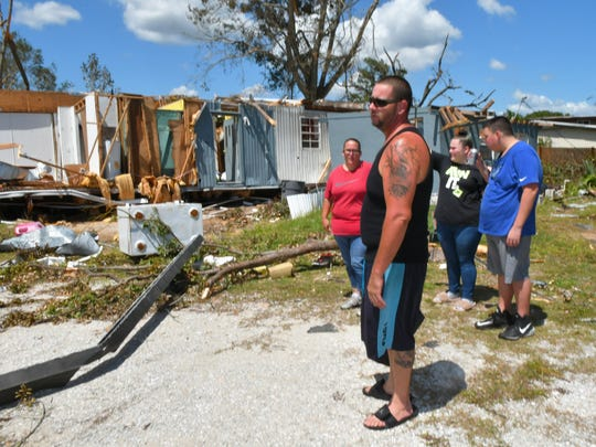 Left to right is Lisa and David Justice and two of their five children,  Hayley Ellenburg, and David, Jr.The family had their manufactured home in Mims destroyed from a tornado spawned by Hurricane Irma. Several other homes were damaged by this same tornado.