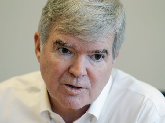 NCAA President Mark Emmert responds to a question during an interview Oct. 27, 2014, in Indianapolis.