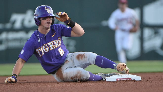 Cole Freeman sitys after being put out at second base as LSU takes on Arkansas April 7, 2017 in Fayetteville Photo by Chris Daigle special to the Advertiser