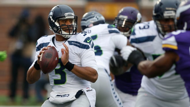 Seattle Seahawks quarterback Russell Wilson (3) looks to throw against the Minnesota Vikings in the first half of an NFL football game in Minneapolis. The Seattle Seahawks will play the Baltimore Ravens on Sunday, Dec. 13, 2015.