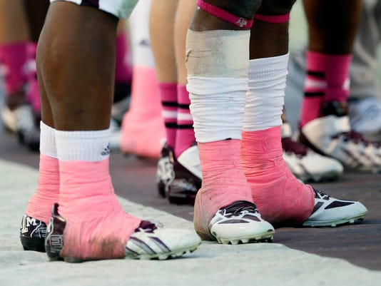 3715d8c4d31 Ankle tape can be sticky situation in college football