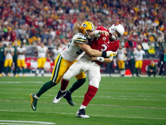 Green Bay Packers inside linebacker Clay Matthews (52) hits Arizona Cardinals quarterback Carson Palmer during the teams' meeting in December in Glendale, Ariz.