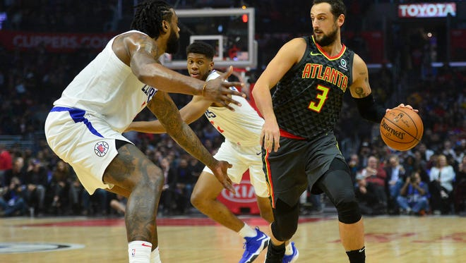 Atlanta Hawks guard Marco Belinelli (3) moves the ball against Los Angeles Clippers center DeAndre Jordan (6) during the first half at Staples Center.