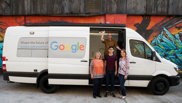 In this Wednesday, March 9, 2016 photo, Google User Experience Researcher John Webb, background, Dawn Herman, left, Henry Liang, center, and Victoria Sosik pose for a photo with Google's User Experience van in New York.