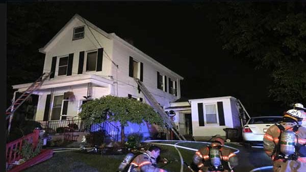 Firefighters at a Norwood home Thursday night.