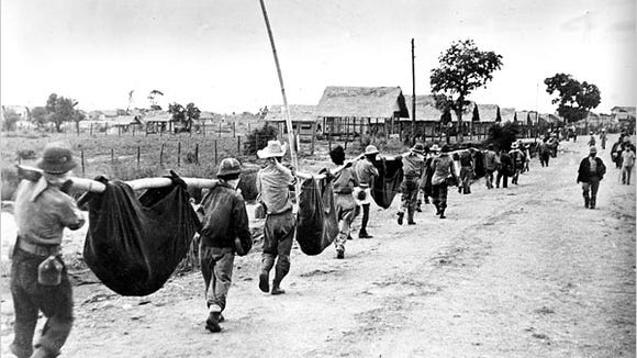 American and Filipino troops on a burial detail weeks after the April 1942 Bataan Death March, a 66-mile ordeal in that remains a hallmark of brutality.