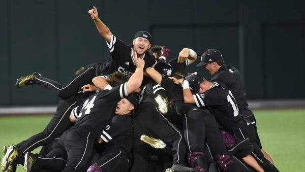 In this June 11, 2018, photo, Mississippi State celebrates after beating Vanderbilt 10-6 in an NCAA college baseball tournament super regional game in Nashville, Tenn. The opening weekend of Mississippi State's baseball season couldn't have been much more demoralizing. The proud program lost three straight games, lost its head coach and had gained multiple excuses to totally fall apart. Instead, their season will end at the College World Series. (AP Photo/Mike Strasinger, File)