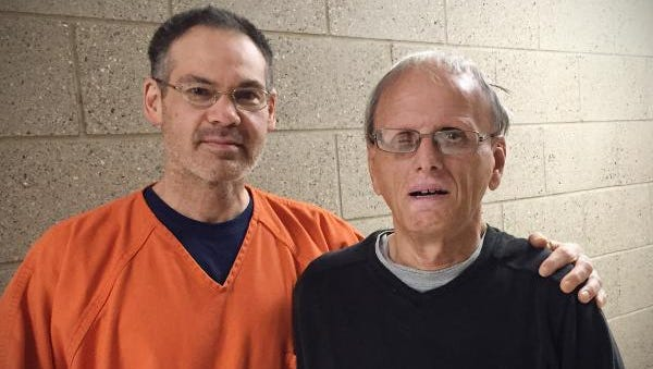 Inmate Michael Simpson, left, performed the Heimlich maneuver on Dennis Kay at the Stearns County Jail, saving Kay from choking during lunch in September. Kay was at the jail as part of a program called Residents Encountering Christ, a ministry that seeks to spread the Gospel to inmates.