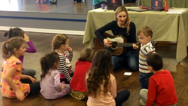 """Lafayette native Jessica Collaço leads a sing-along song with about 40 kids and parents Saturday, Nov. 29, after reading them her first inspirational children's book, """"Firenze's Light,"""" at Studio b Dance & Fitness in Lafayette."""
