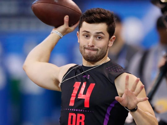 Oklahoma quarterback Baker Mayfield throws a pass during the 2018 NFL Combine at Lucas Oil Stadium.