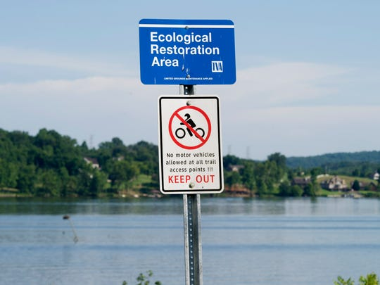 """A sign reading """"Ecological Restoration Area"""" at TVA Lakeshore Park in Harriman, Tennessee on Tuesday, July 11, 2017."""