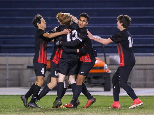 The West Florida High players celebrate after Justin Schubeck (9) scored the second goal of the game against Choctaw during the District 1-3A championship game at Gulf Breeze High School on Friday, February 2, 2018. The Jaguars defeated the Indians 2-0.