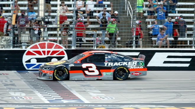 Austin Dillon crosses the finish line to win the NASCAR Cup Series auto race at Texas Motor Speedway in Fort Worth, Texas, Sunday, July 19, 2020.