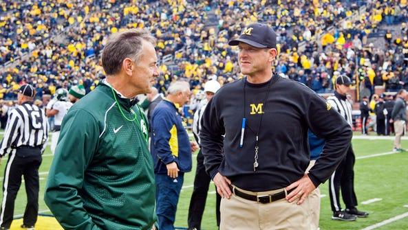 Michigan State coach Mark Dantonio speaks with Michigan