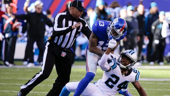 A referee separates New York Giants wide receiver Odell Beckham Jr. (13) and the Carolina Panthers' Josh Norman (24) Sunday.
