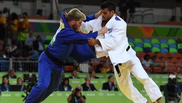 Nicholas Delpopolo (left) fights Sagi Muki in a men's 73-kg quarterfinal round match at Carioca Arena 2 during the Rio 2016 Summer Olympic Games.