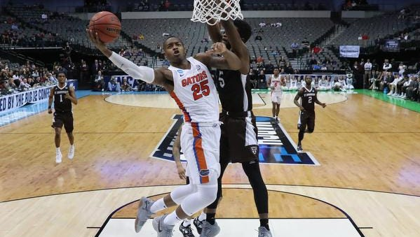 Keith Stone #25 of the Florida Gators goes up for a shot against Tshiefu Ngalakulondi #5 of the St. Bonaventure Bonnies in the second half in the first round of the 2018 NCAA Men's Basketball Tournament at American Airlines Center on March 15, 2018 in Dallas, Texas. The Florida Gators won 77-62. (Photo by Tom Pennington/Getty Images)