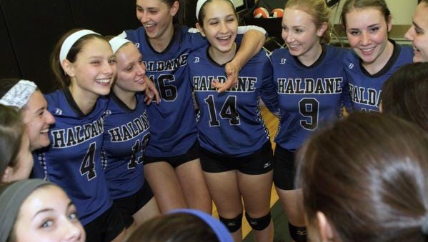 The Haldane volleyball team celebrates its sweep over S.S. Seward Tuesday in the Class D regional semifinal at Croton-Harmon High School.