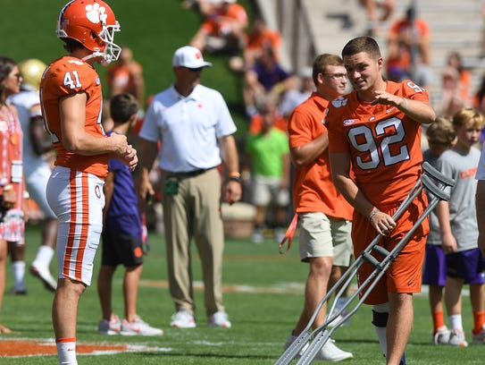 Clemson place kicker Alex Spence (41) gets some pointers