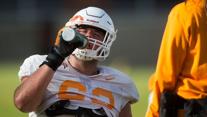 Tennessee offensive lineman Brett Kendrick (63) takes a drink during a University of Tennessee fall football practice at Anderson Training Facility in Knoxville, Tenn. on Tuesday, Oct. 24, 2017.