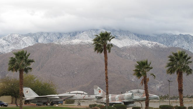 Snow is seen in mountains surrounding the Coachella Valley on Thursday morning, Feb. 16, 2012, a day after a storm brought more than a quarter-inch of rain to the valley and 8 inches of snow to Idyllwild. The snow level dropped to about 3,000 feet in elevation, a National Weather Service meteorologist said.