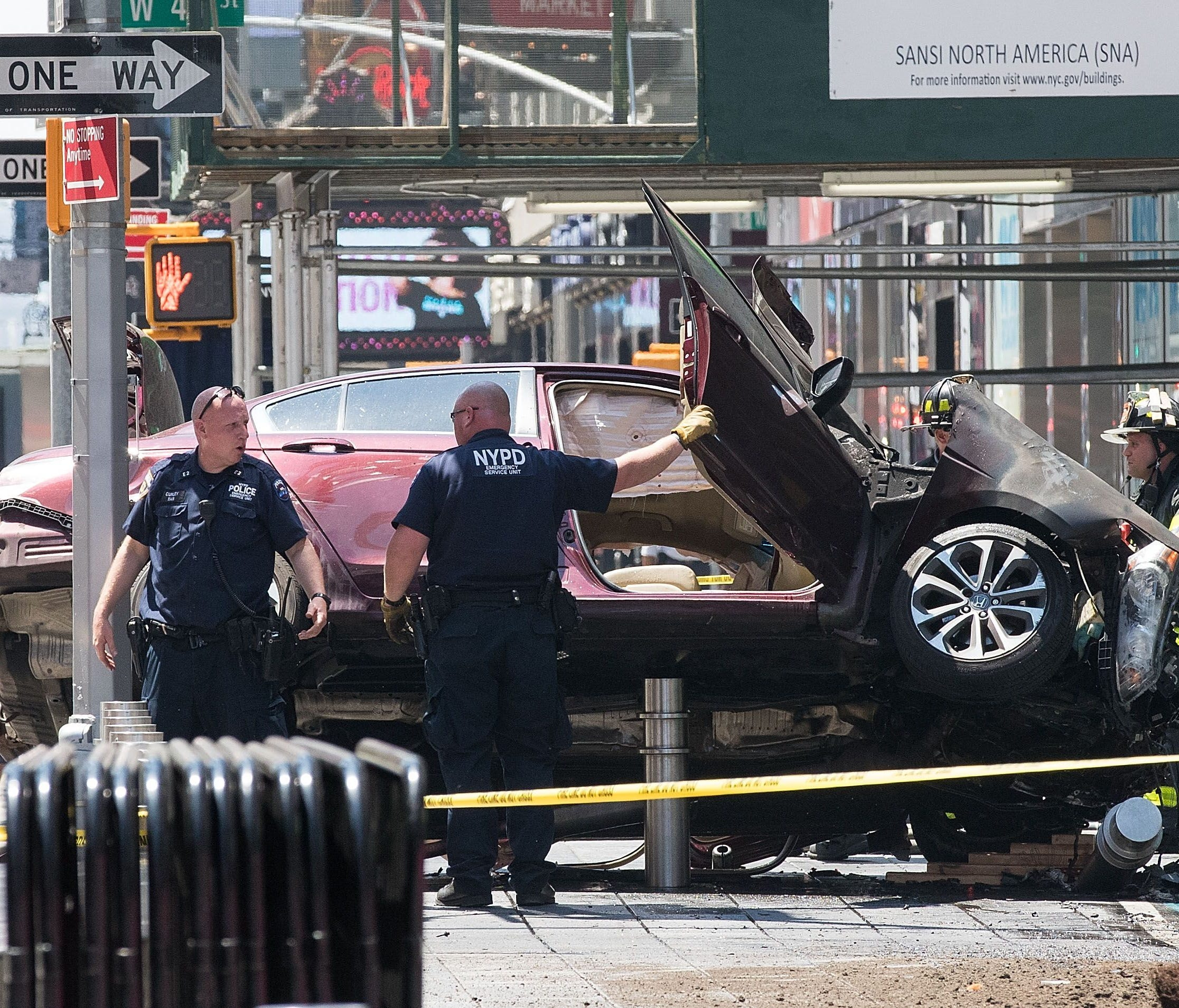 A wrecked car sits in the intersection of 45th and Broadway in Times Square, May 18, 2017 in New York. According to reports there were multiple injuries and one fatality after the car plowed into a crowd of people.