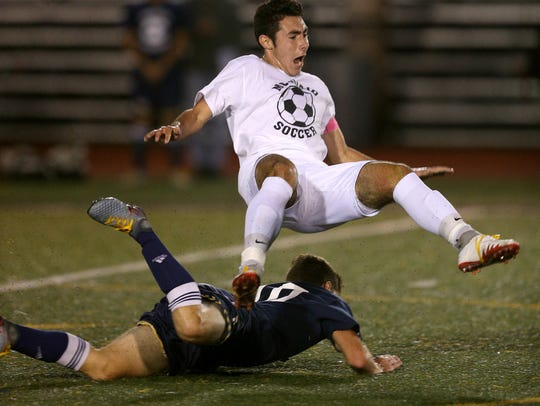 McQuaid's Adriano Margiotta is tackled off his feet
