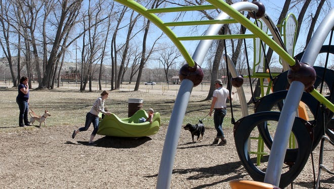 Families on Friday enjoy Riverside Park in Aztec. At an upcoming work session, the Aztec City Commission will discuss the proposed Parks and Recreation Enhancement Plan, which includes $100,000 for riverbank stabilization at Riverside Park.