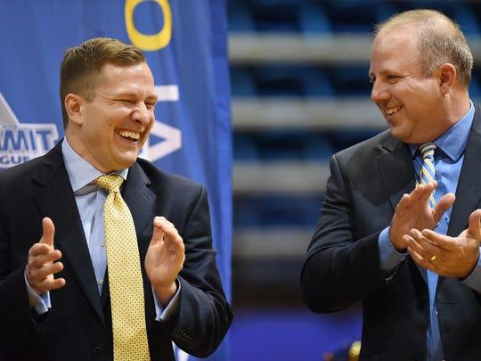 T.J. Otzelberger (left) shares a laugh with SDSU's