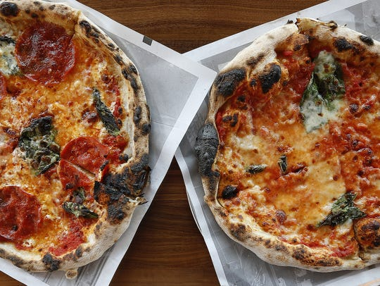 The Enquirer/Cara Owsley The Diavola, left, a red pizza