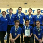 Salem bowling coach Kathie Hahn (far left) and her varsity boys team pose after the squad placed second at Saturday's tournament in Bay City.