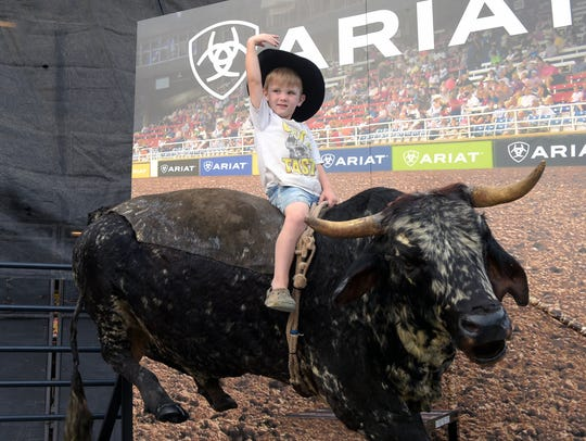 Karson Ozburn,4, poses for a photograph at the bull