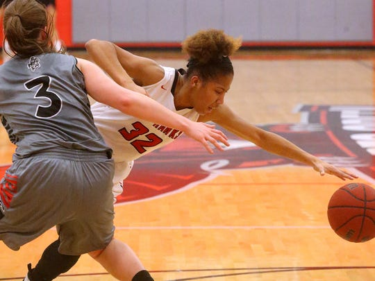 Stewarts Creek's Brianah Ferby (32) goes after a ball that got away from her as Coffee County's Holli Smithson (3) guards her on Friday, Feb. 24, 2017 the quarter final round of Regional play.