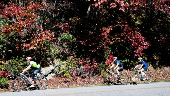 Cyclists ride along the Blue Ridge Parkway October