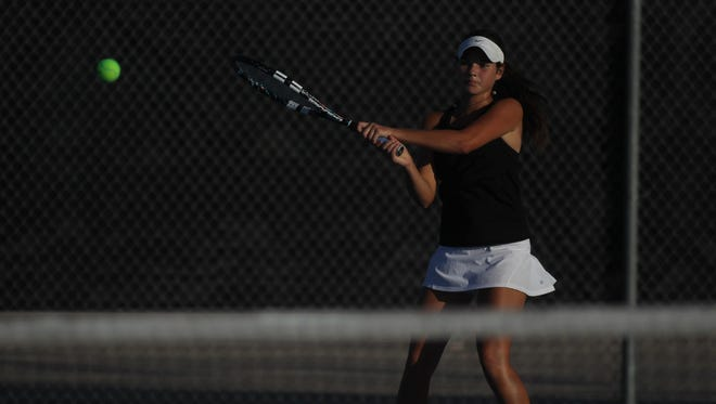 Chiles' Gracie Wilson plays a backhand during doubles play against Niceville in Thursday's Region 1-3A final. Wilson won at No. 3 singles and No. 2 doubles to help the Timberwolves win 4-3 and advance to the state tournament.