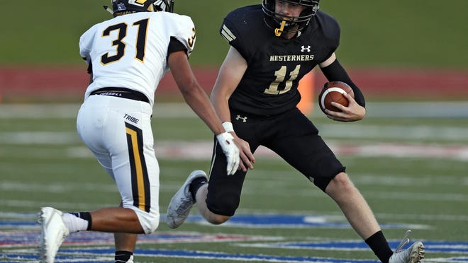 Lubbock High quarterback Brandon Smith (11) runs with the ball around Seminole's Emilio Aguilar (31) during a nondistrict game on Aug. 29, 2019 at PlainsCapital Park at Lowrey Field.