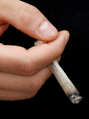 A marijuana cigarette is shown. A poll by the University of Delaware finds 61 percent of Delawareans favor legalizing pot.