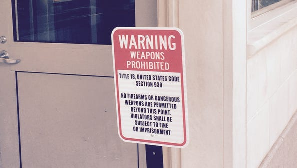 A sign posted at the northwest gate of the White House
