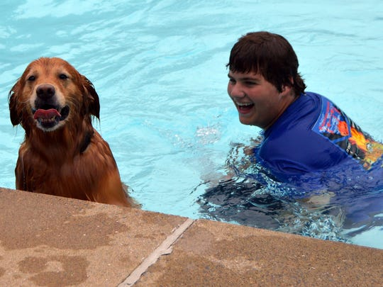 Scout with his family Dakota Padgett having fun in the pool,