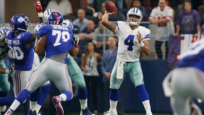 Dallas Cowboys quarterback Dak Prescott (4) throws a pass in the fourth quarter against the New York Giants at AT&T Stadium. New York won 20-19.
