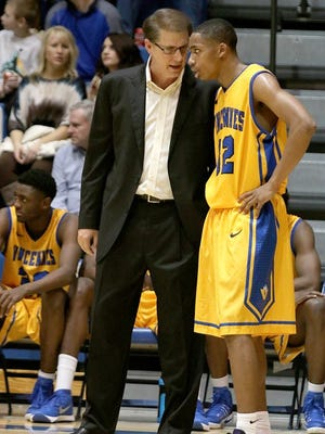 Vincennes University head coach Todd Franklin, left, chats with Chris Darrington, who is ranked among the top junior-college point guards in the nation.