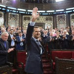 A handout picture made available by Syrian Arab news agency SANA shows Syrian President Bashar Assad arriving at the Syrian parliament in Damascus on June 6, 2016.