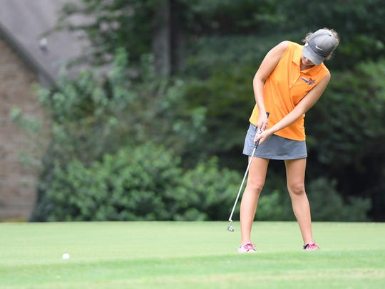 South Gibson County's Sally Tiger putts from the green