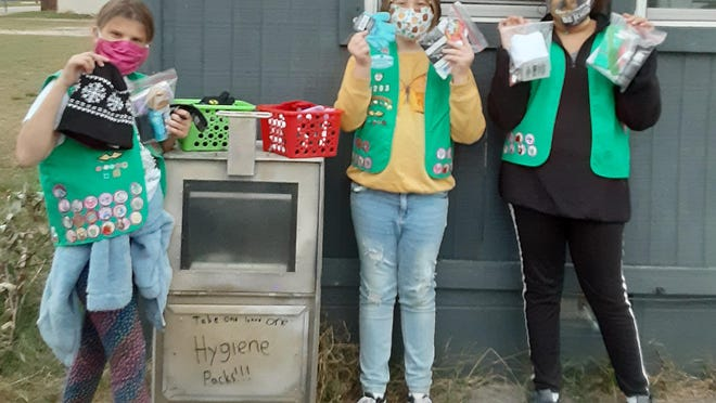 Girl Scouts with Troop 4293 have been working on their Bronze Award and recently delivered hygiene packs and winter items to Pay It Forward Food Pantry in Fort Smith. As part of their project the scouts will be holding a drive on Nov. 7 from 10 a.m. to noon at Pay It Forward, 616 North 10th St. They will be collecting new hygiene products and also winter items. Pictured are junior scouts Laurn Henry, 10, Jillian Houle, 10, and Bella Perguson, 10. Not pictured are Lily Ulrich, 10, and Lilly Turner, 10.